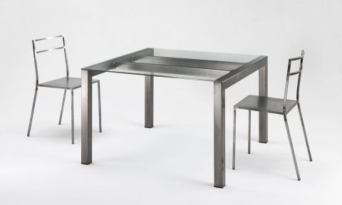 Tavolo in acciaio e vetro di design
